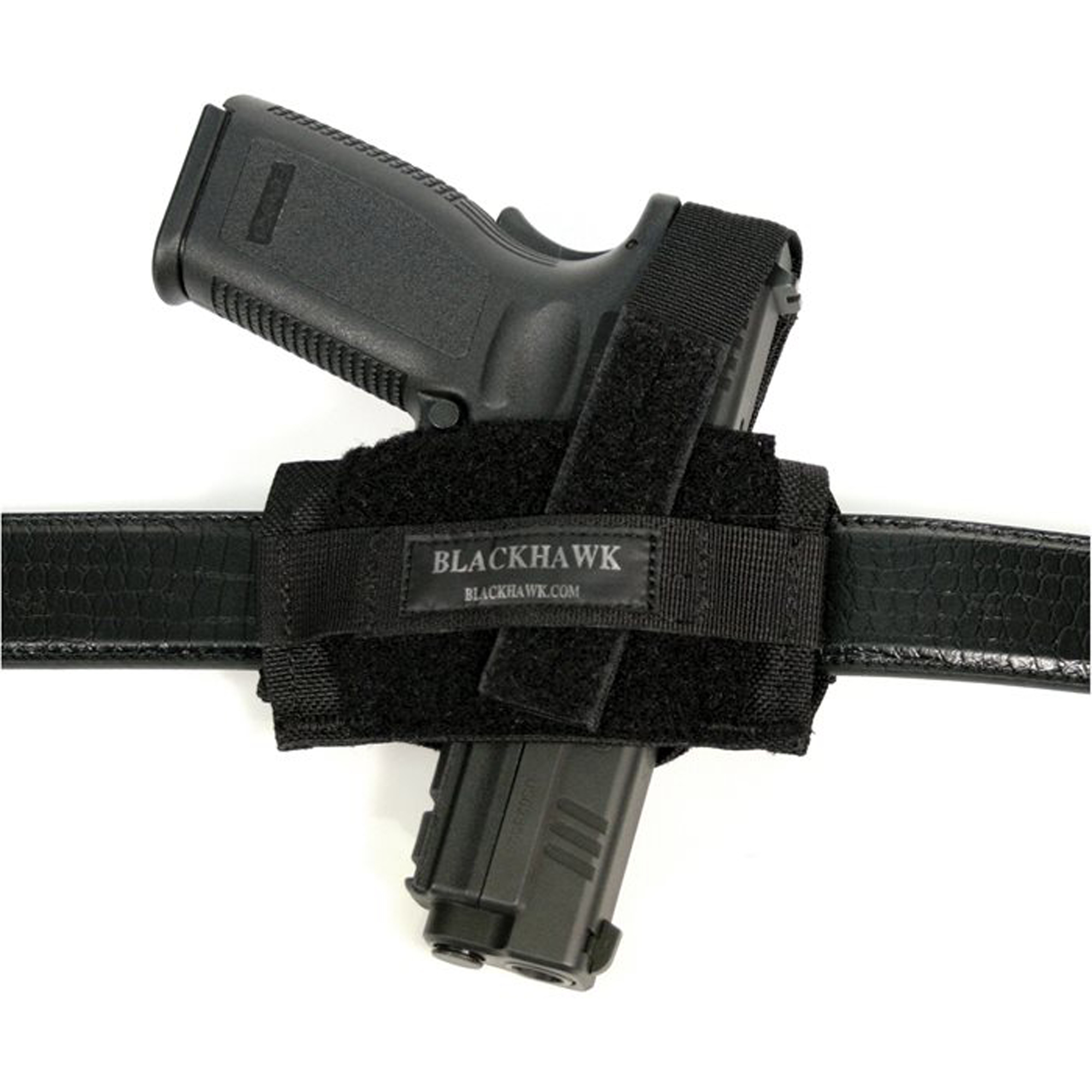 """The Nylon Ambidextrous Flat Belt Holster hugs tight against your body"""" offering a low-profile carry option. Fits belts up to 2"""" wide and features an adjustable and reversible thumb break."""
