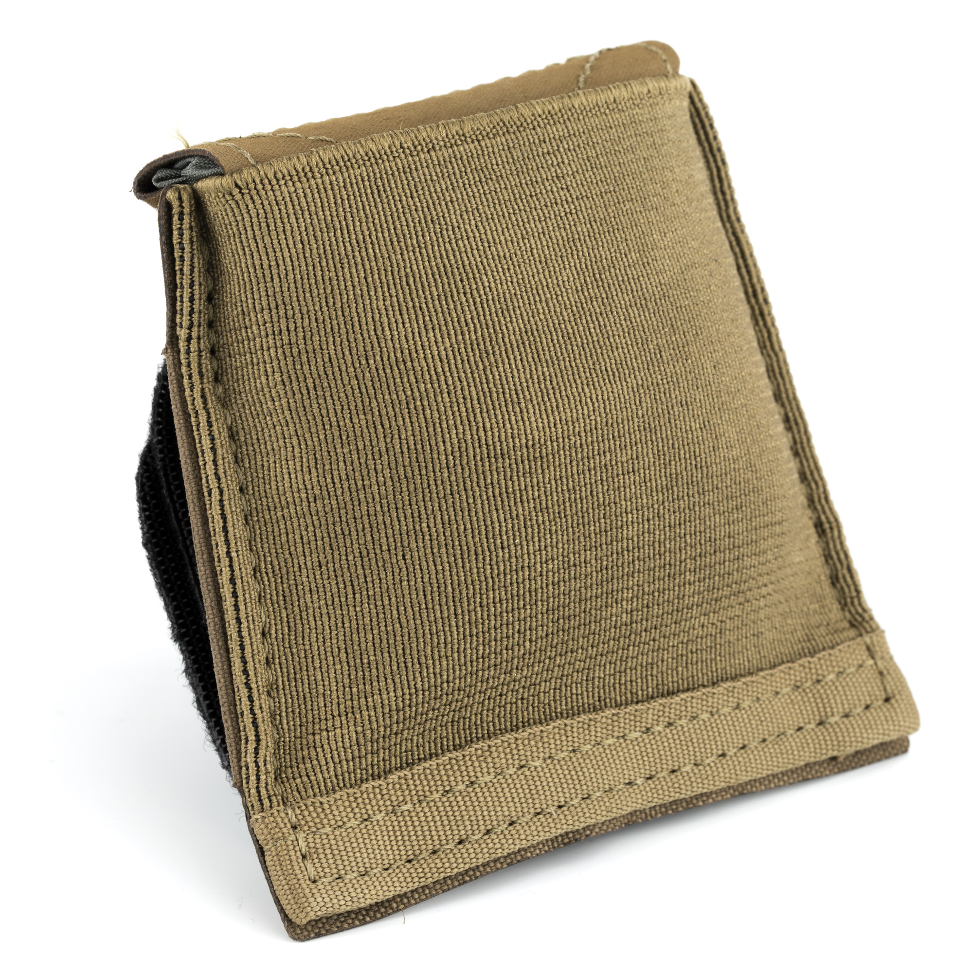 """The Belt Mounted Dump Belt Pouch brings the redefining Ten-Speed(R) Ultralight Dump Pouch to your belt. While not in use"""" the pouch's bag portion stays folded under Ten-Speed(R) elastic"""" making it extremely compact. When needed"""" a simple pull on the bottom tab deploys a bag big enough to hold 10 M4 magazines. The stowed pouch is small enough to be mounted to belts"""" and eliminates the potential snag hazard created by bulky bags which have the tendency to flop around. A cinch cord at the top of the bag can be closed with one hand to secure the contents of the dump pouch. The Dump Belt Pouch sufficiently functions as a traditional magazine dump pouch"""" or as a temporary supplemental pouch for items like breaching charges"""" provisions"""" SSE items"""" trash"""" spent casings"""" or extra water bottles during infiltration. The rip stop nylon bag can be used for foraging for food"""" kindling"""" or even work as an emergency water filtration component."""