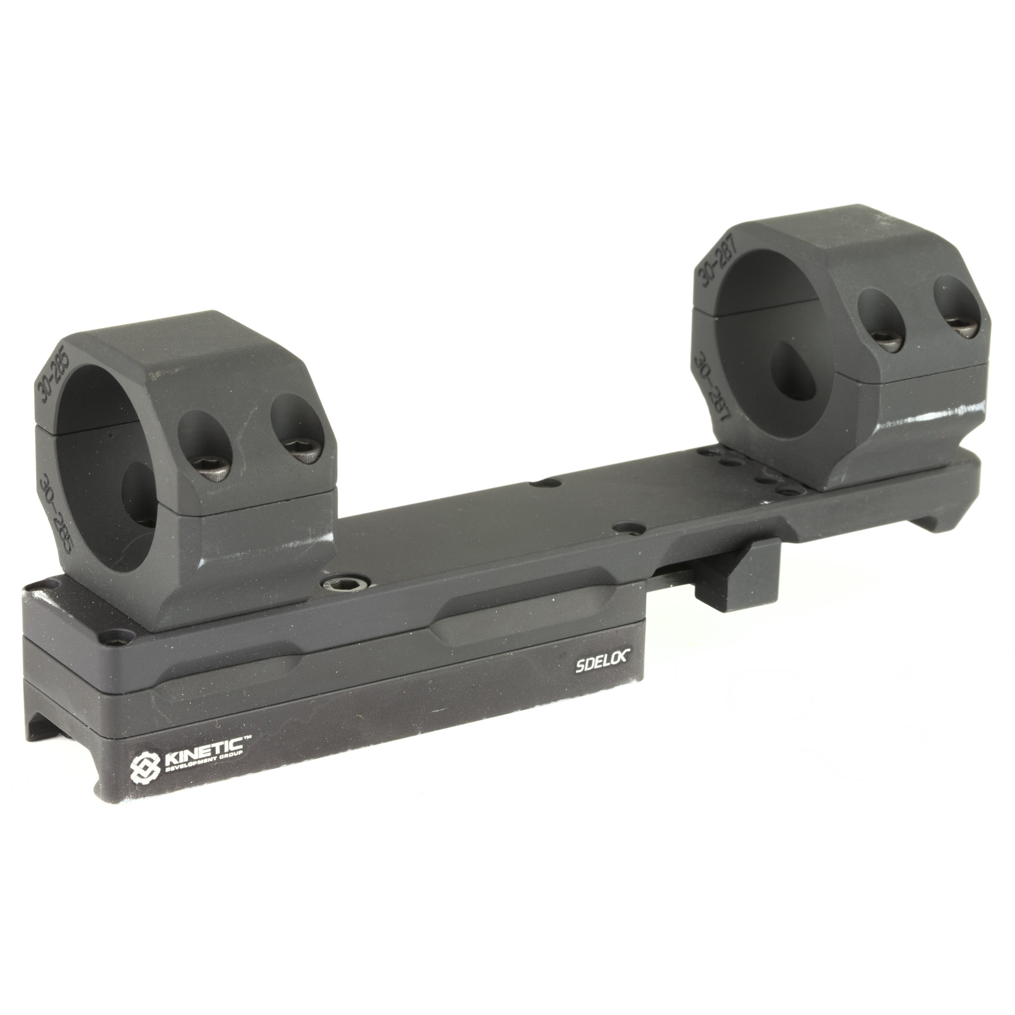 """The new KDG Modular Optic Mount is based off the proven Sidelok family of quick detach optic mounts"""" and features the same user-friendly"""" tool less design. KDG set out to design a Sidelok mount for all common"""" tube-style optics that will offer more user-configurable options than what is currently available from competing QD mounts. The mount is offered with a user removable cantilever bar"""" in which the rings securely mount. This bar runs parallel to the weapon's bore"""" and is ideal for all semi and fully automatic carbines"""" rifles and DM style firearms. The matched front and rear rings are CNC machined"""" and wire EDM cut to be as precisely concentric as possible. The upper and lower ring remain matched for the duration of its production"""" and feature witness marks for assembly in the form of recessed dots. This allows the user to match the proper ring to its base"""" and ensure the mount is as truly aligned as possible. The rings themselves can be adjusted forward or back to the user's preference"""" to avoid interference with large front objective bells"""" turret adjustment knobs"""" and rear magnification adjustment collars. The rings themselves bolt into a track system to facilitate this adjustment. The same track system allows the user to purchase and install separate rings in the future"""" should they decide to change to an optic with a larger or smaller diameter tube. This feature will save the shooter or organization money"""" as the majority of cost is in the base of the unit."""