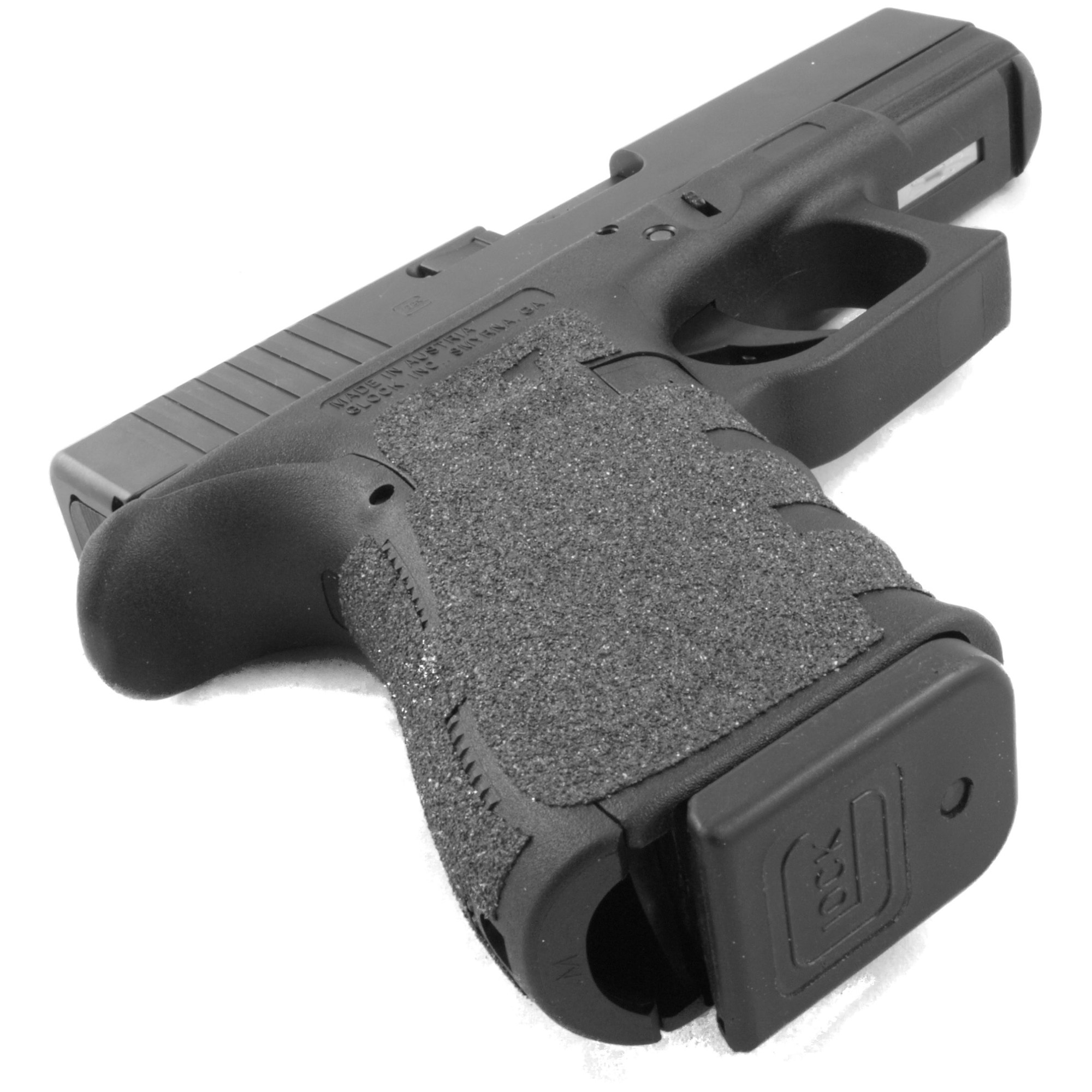 """TALON Grips for Glock Model 19"""" 23"""" 25"""" 32"""" and 38 models Gen 1"""" 2"""" 3. This rear wrap grip is in the granulate texture. This grip provides full coverage on the side panels including above the thumb rest"""" ample coverage on the backstrap"""" and three finger wraps for the finger groves under the trigger guard. This grip has a logo cutout for the Glock emblem on the left side of the handle. This grip sticks extremely well even with the Rough Textured Frame (RTF)."""